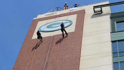 """Bishara & Chyna make their way down – stopping to admire the famous Packers """"G"""""""