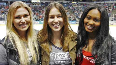 The FOX Sports Wisconsin Girls check out the rink-side view to catch all the action on the ice.
