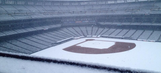 Denver snowstorm blankets Coors Field in white