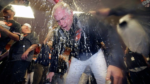 Orioles skipper Buck Showalter gets drenched