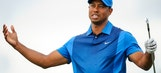Tiger Woods hits three wedge shots into the water on television