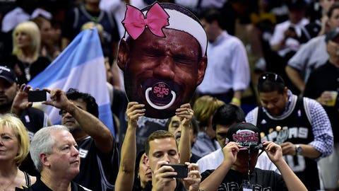 Spurs fans put a pacifier on LeBron James during the NBA Finals