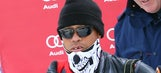 Masked and missing a tooth, Tiger Woods surprises girlfriend Lindsey Vonn