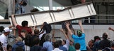 Piece of paneling from video board falls on fans at French Open
