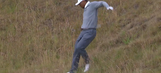 Oof: Tiger Woods falls on his rear while sizing up his ball