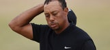 Tiger Woods' terrible day includes lost club, 'cheater' banner