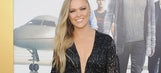Ronda Rousey channels Rocky for next fight; must-see slide; more