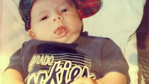 Baby Jordan Spieth rocking a Rockies shirt