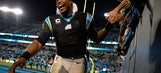 Cam Newton wipes out while high-fiving Carolina Panthers fans