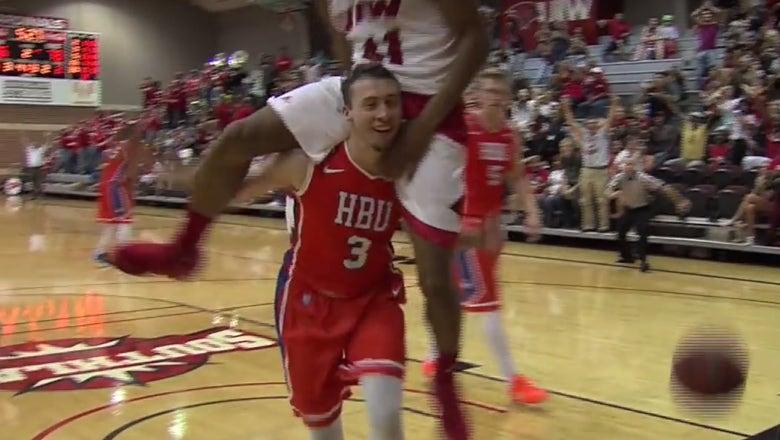 Helpless defender gives player piggyback ride after being dunked on