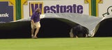 LSU grounds crew member trips three times, gets swallowed up by tarp