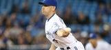 The Blue Jays' ambidextrous pitcher inspires a 'bobblearms' figurine