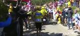 Tour de France leader starts running up mountain after crashing his bike