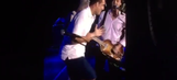 Gronk plays air guitar alongside Paul McCartney at a Fenway Park show