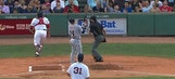 Umpire catches Red Sox catcher's flying mask on play behind plate