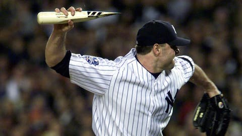 Roger Clemens rockets a bat in the direction of Mike Piazza (October 2000)