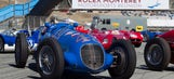 Classic cars compete on track during 2014 Monterey Motorsports Reunion