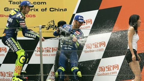 Podium girls getting sprayed with Champagne