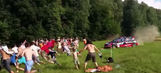 WATCH: Fleeing crowd narrowly escapes from out-of-control rally car