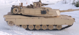 Watch tanks drift in the snow