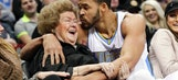 Nuggets' JaVale McGee adorably kisses fan's cheek after landing in front row