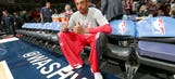 Paul Pierce autographs Celtics fan's shoes on Wizards' bench