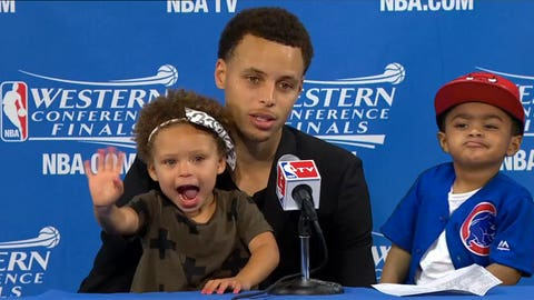 This is NOT how to mug at Dad's postgame presser
