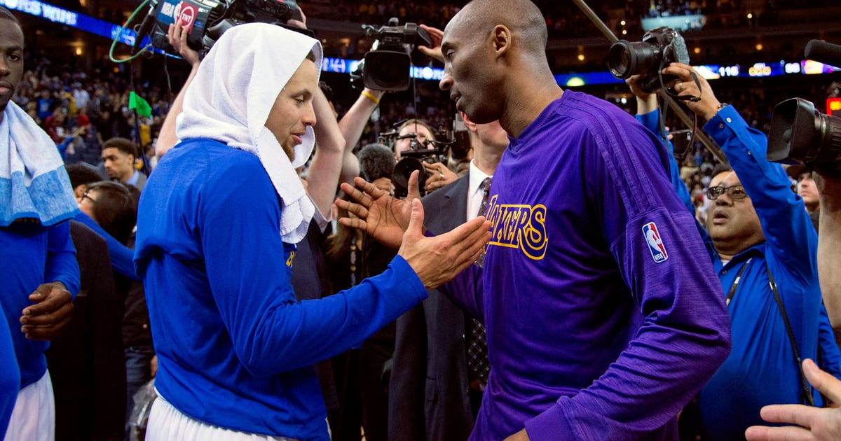 Kobe passes torch to league's reigning MVP Curry by signing his jersey