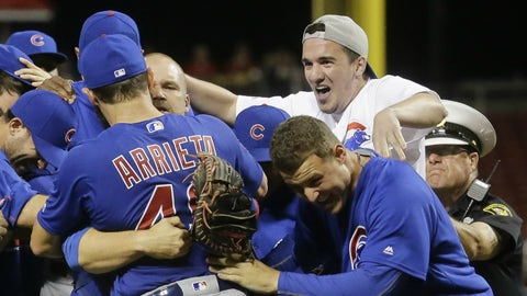 A Cubs fan rushes the field after Jake Arrieta's no-hitter and joins the celebration (April 21)