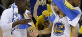 Steph Curry knocked off his seat in disbelief after Draymond Green nails a 3
