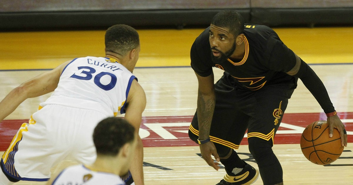 29877a7504fc Watch Kyrie Irving hit the 3 over Stephen Curry that clinched the  Cavaliers  title