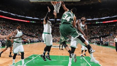 Giannis Antetokounmpo twists over the Celtics