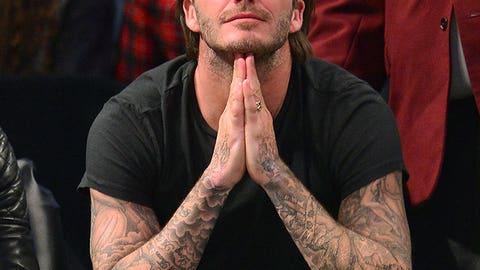 David Beckham sitting court-side