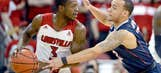 No. 11 Louisville blows out No. 19 UConn, claims share of AAC title