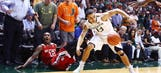 Miami fan shoves N.C. State player Anthony Barber during game