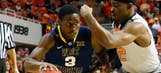 Staten, Browne lead No. 23 West Virginia over No. 22 OK State