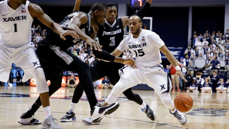Myles Davis' triple-double leads No. 8 Xavier over No. 23 Providence