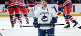 Canucks' Bieksa punts Brian Boyle'€™s helmet across ice after brawl