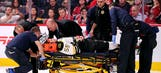 Bruins' Boychuk taken to hospital after scary hit along end boards