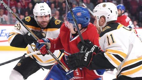 Bruins surround Gallagher