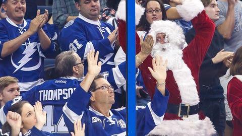 Santa Claus celebrates a goal at NHL game