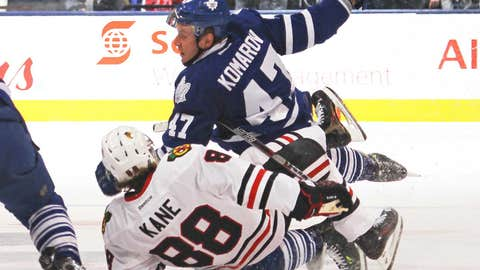 Kane's first career regular-season hat trick paces Blackhawks