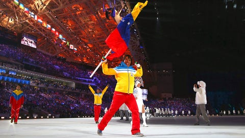 Venezuelan flag bearer gleefully shows he's full of win