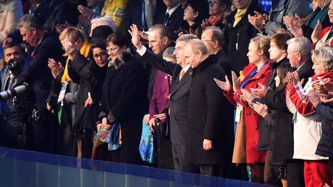 Putin and Bach address the crowd