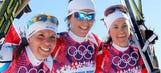 Norway's Bjoergen wins women's 15K skiathlon at Sochi Games