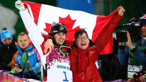 Alex Bilodeau defends gold, celebrates with brother