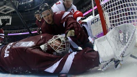 Photos: Latvia goalie was busiest athlete in Sochi on Wednesday