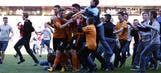 Wolves win nearly abandoned because of multiple pitch invasions