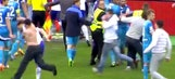 Zenit fan punches Dynamo Moscow player during massive pitch invasion