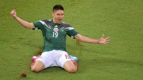 Mexico climbs over obstacles to claim victory over Cameroon